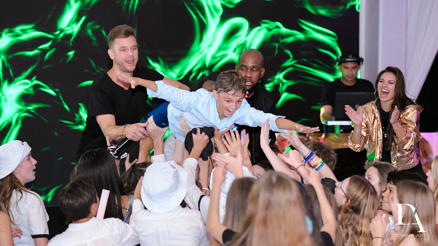 crowd surfing at Masquerade Ball Bat Mitzvah at Ritz Carlton Fort Lauderdale by Domino Arts Photography