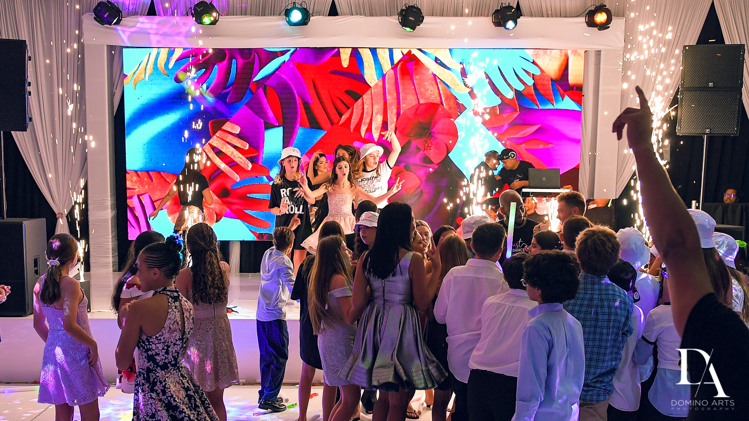 dancing on stage at Masquerade Ball Bat Mitzvah at Ritz Carlton Fort Lauderdale by Domino Arts Photography