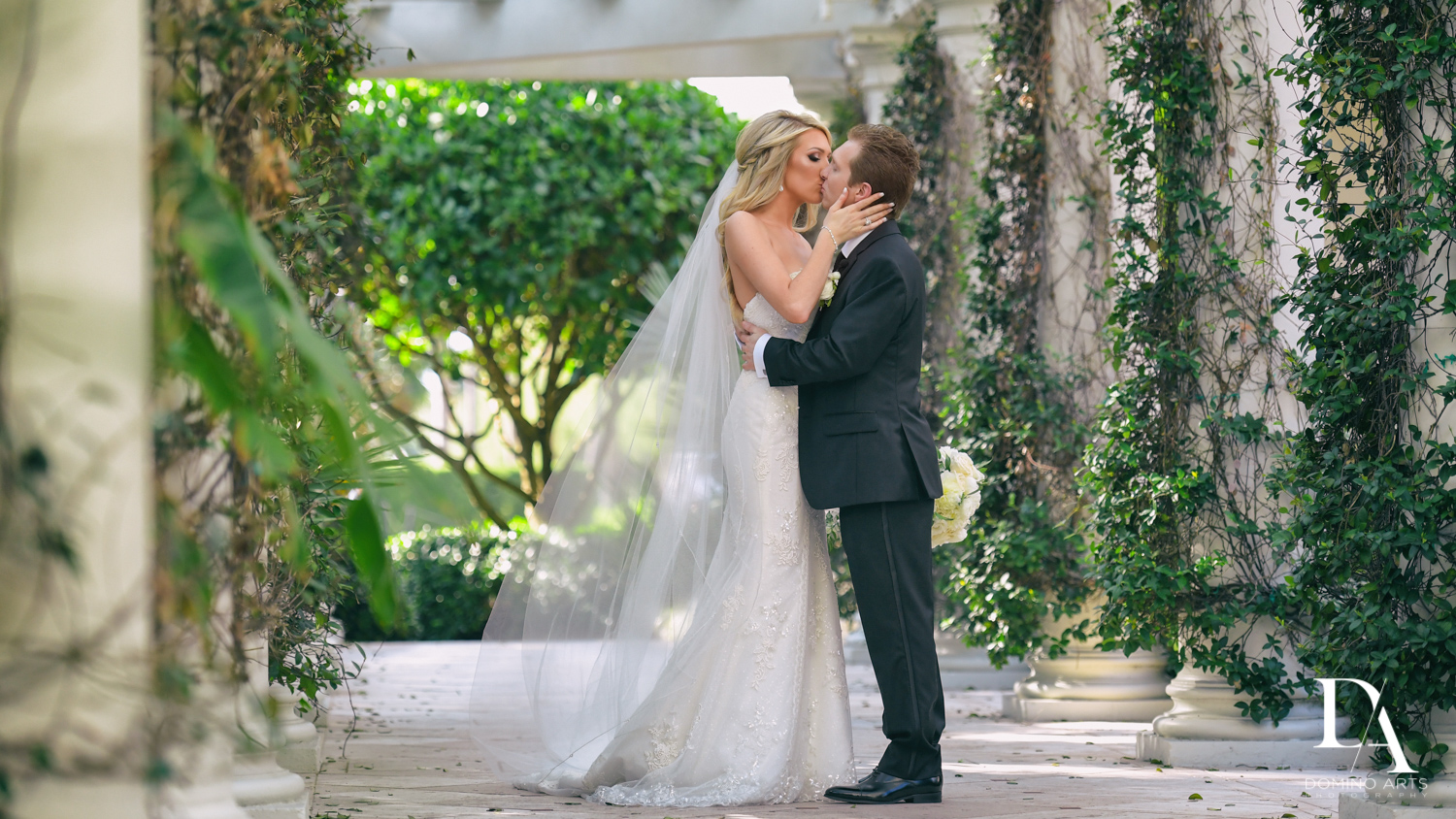 couple kiss at Extravagant Wedding at The Breakers Palm Beach by Domino Arts Photography