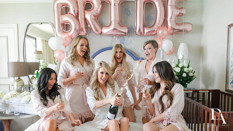 bridesmaids fun at Extravagant Wedding at The Breakers Palm Beach by Domino Arts Photography