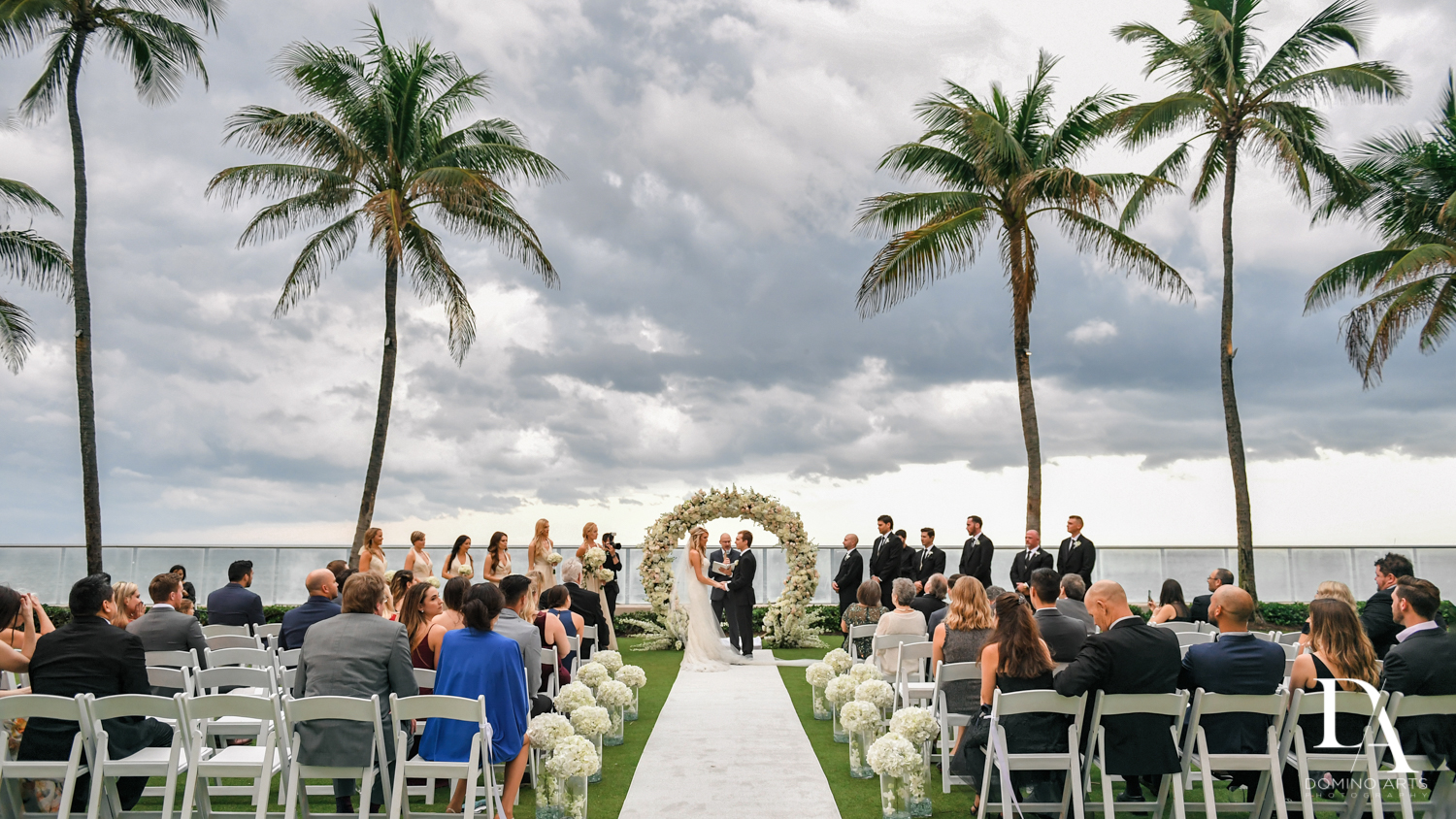 ocean side ceremony at Extravagant Wedding at The Breakers Palm Beach by Domino Arts Photography