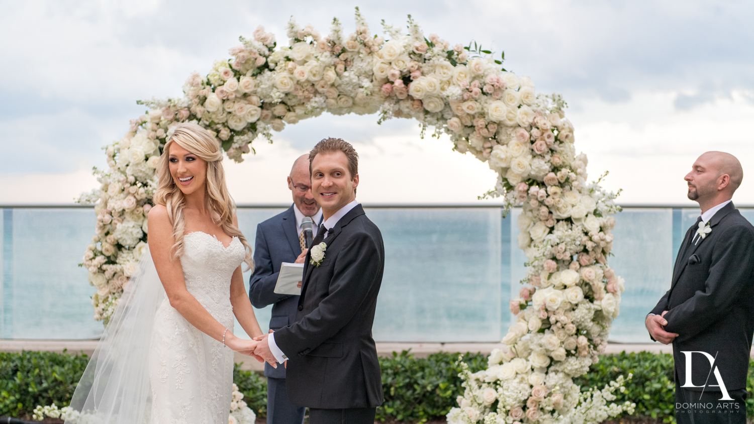 floral chuppah at Extravagant Wedding at The Breakers Palm Beach by Domino Arts Photography