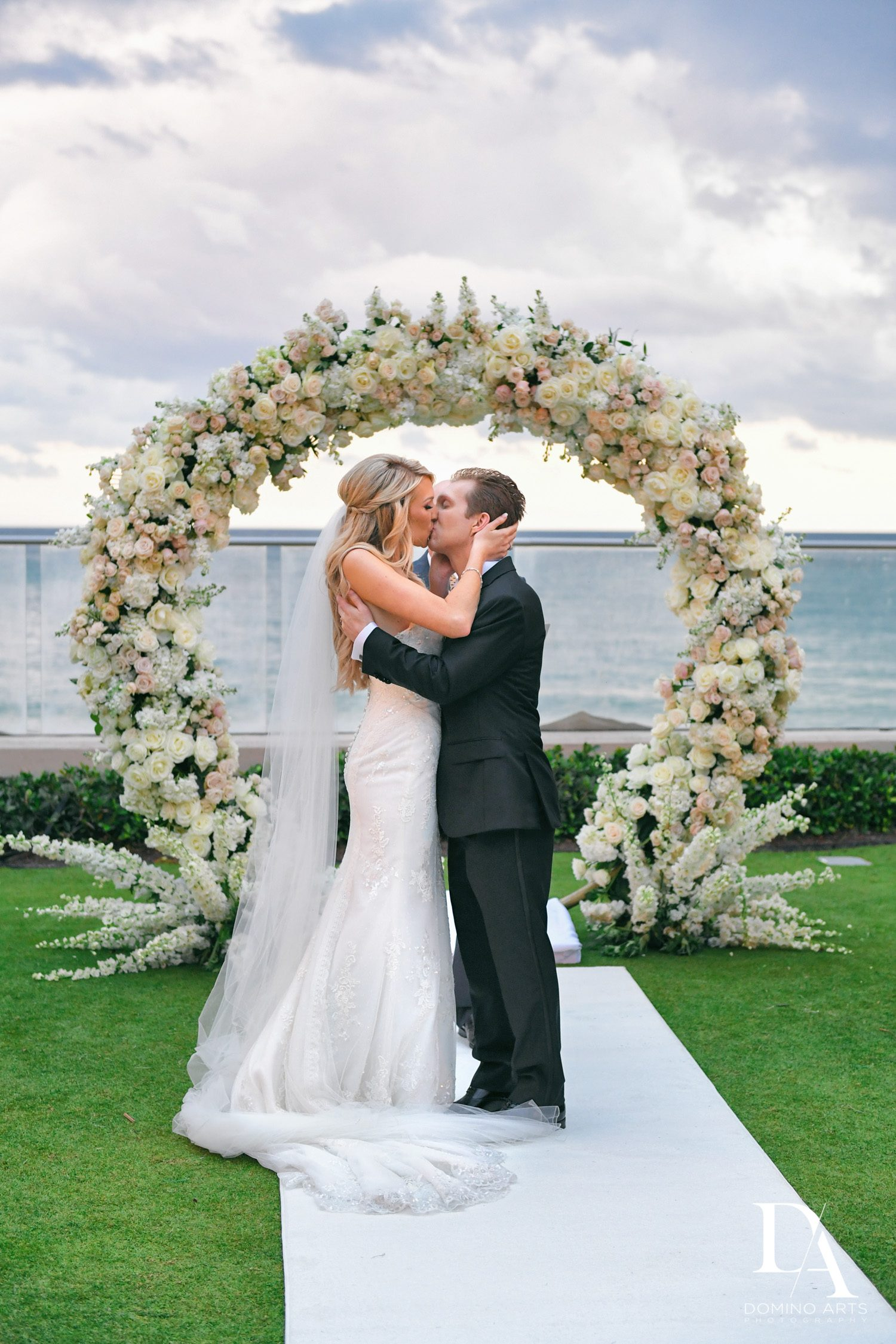 just married kiss at Extravagant Wedding at The Breakers Palm Beach by Domino Arts Photography