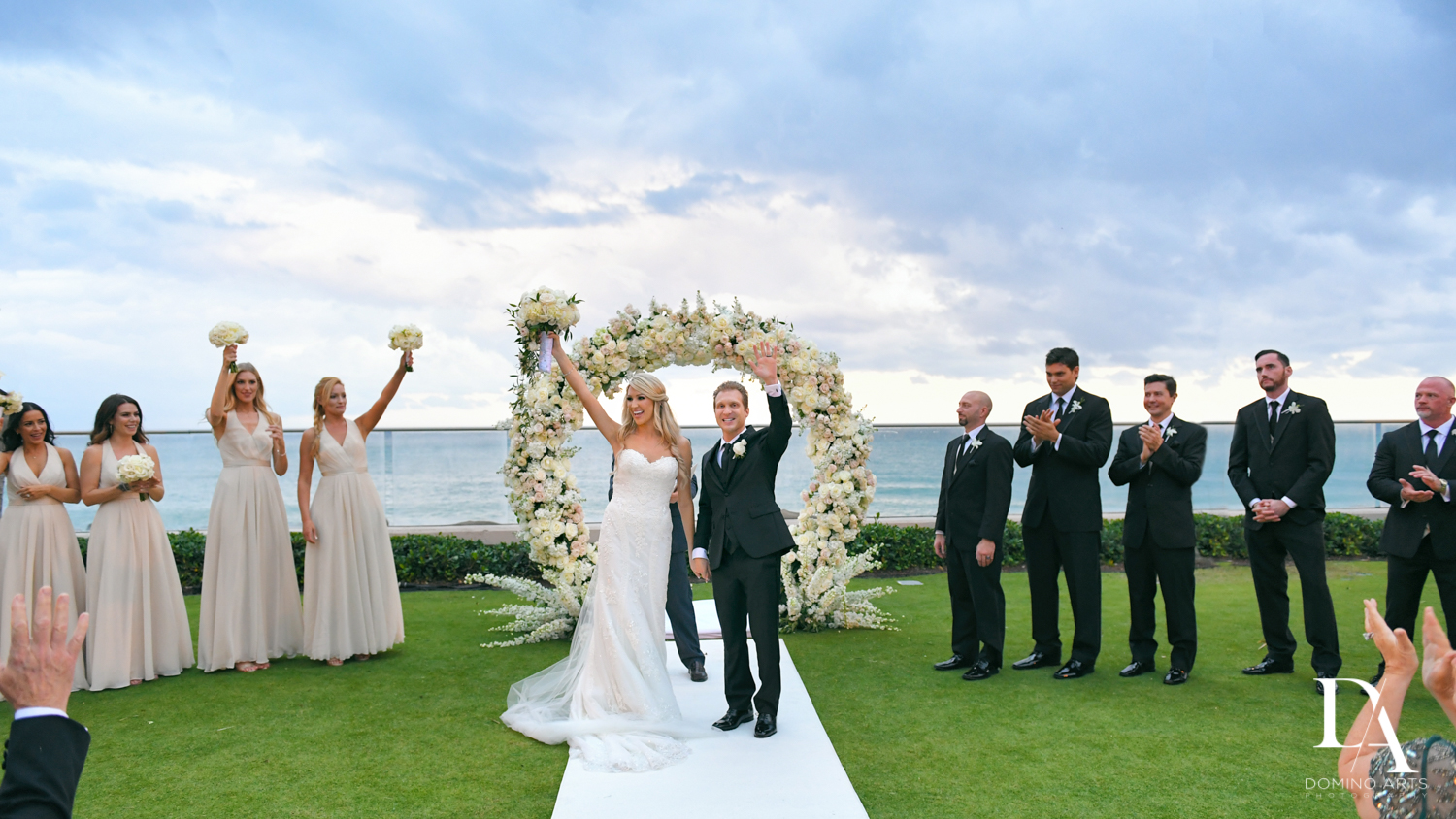 beach wedding at Extravagant Wedding at The Breakers Palm Beach by Domino Arts Photography