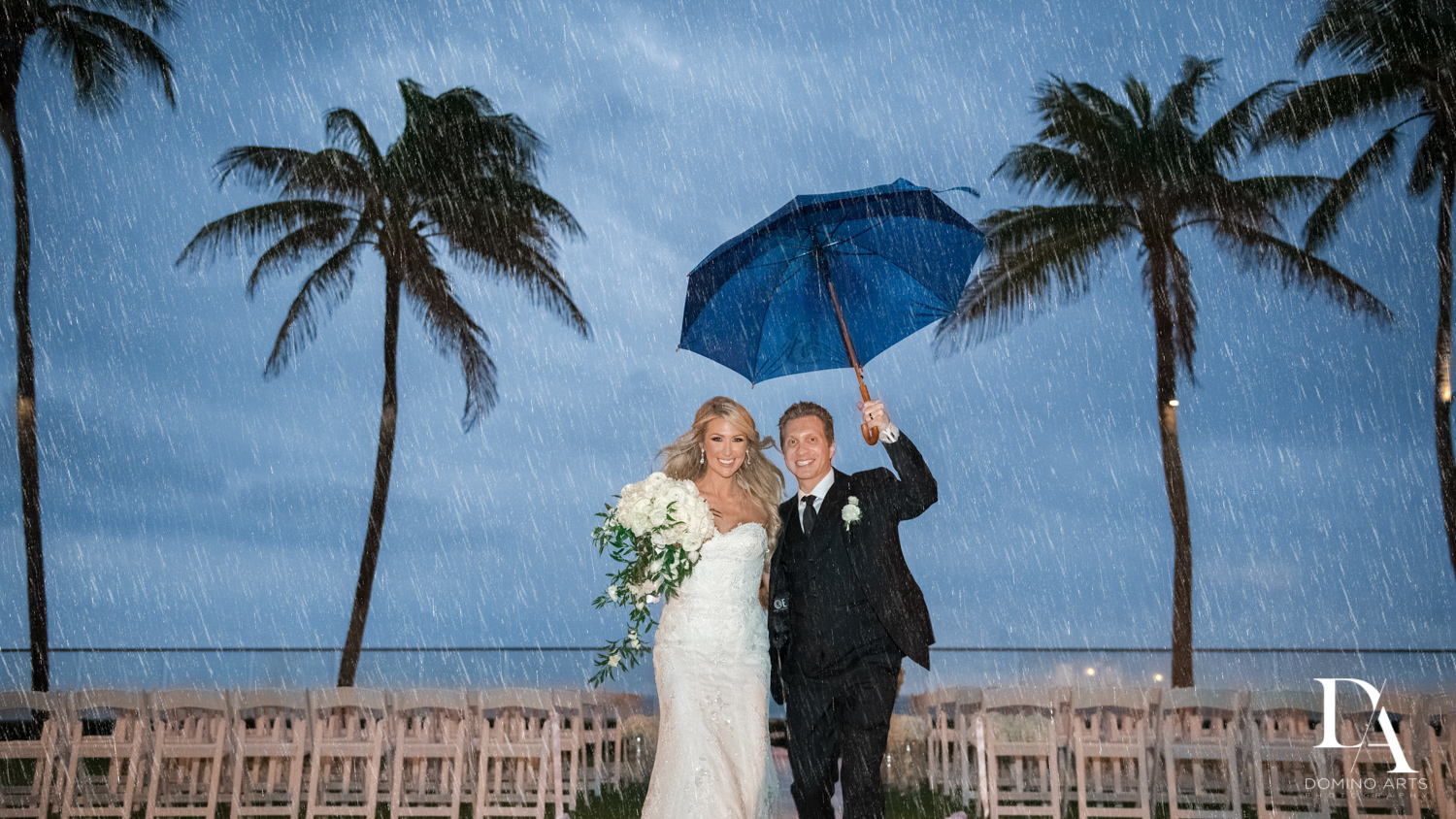 rainy wedding at Extravagant Wedding at The Breakers Palm Beach by Domino Arts Photography