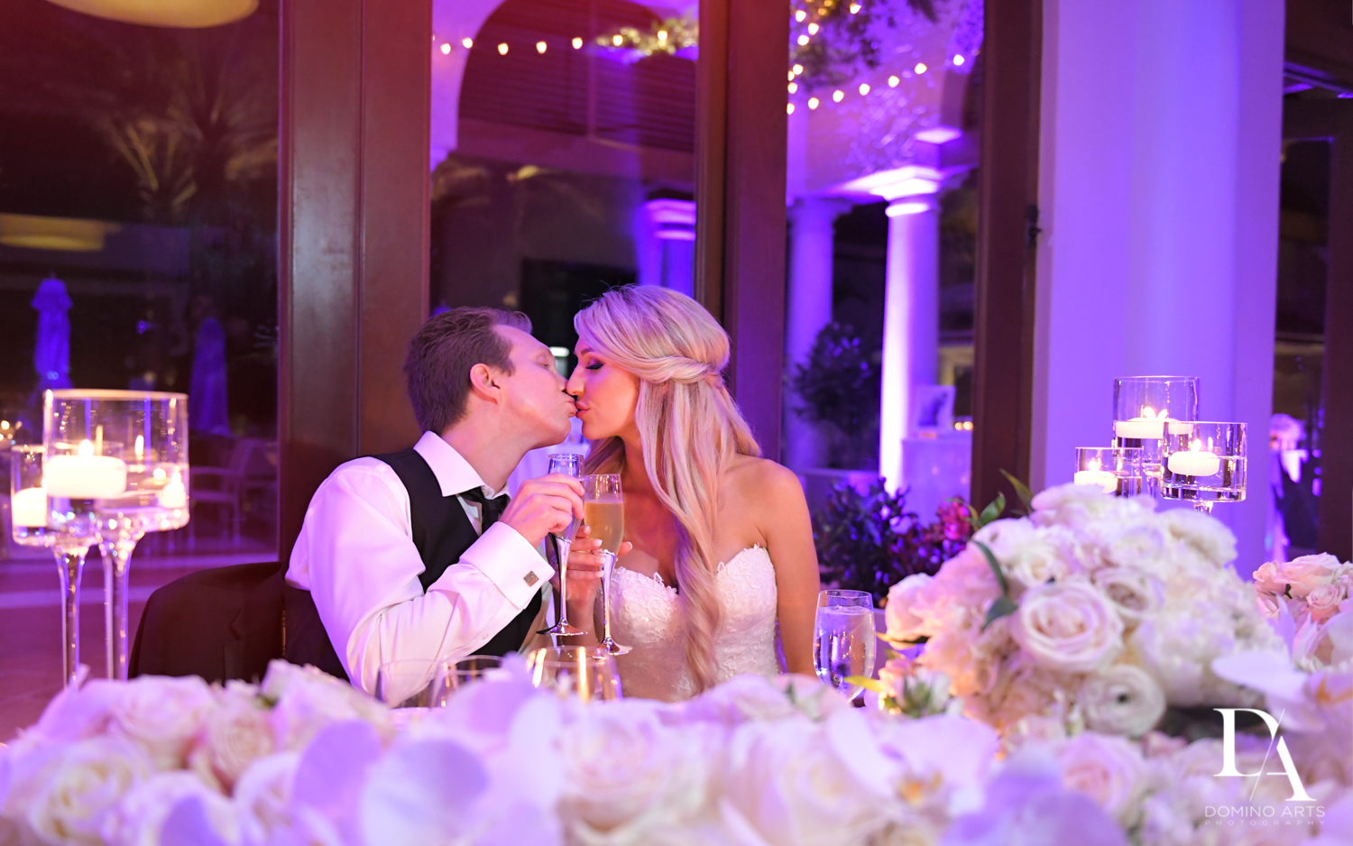 sweet kiss at Extravagant Wedding at The Breakers Palm Beach by Domino Arts Photography