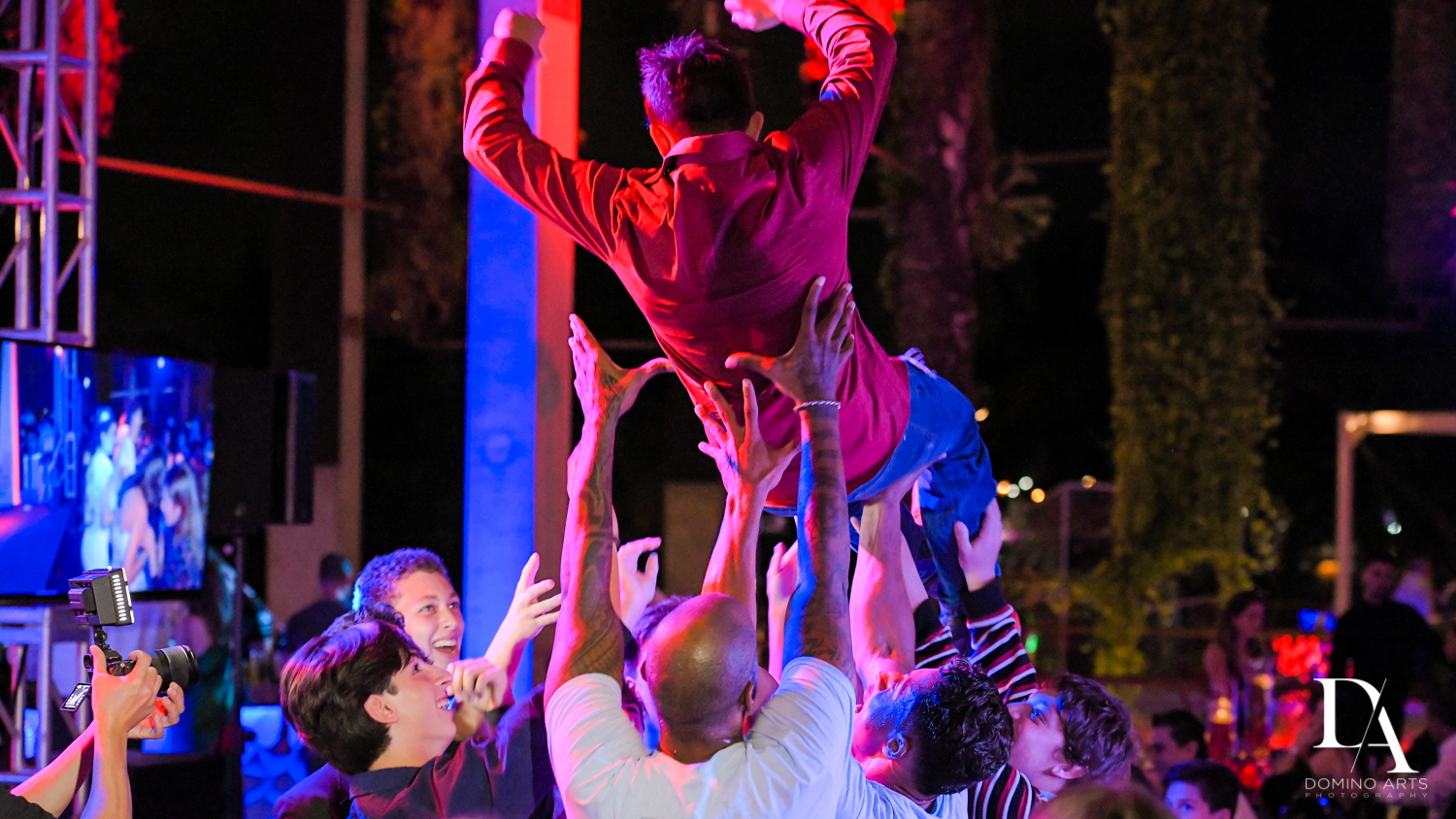 crowd surfing at Fire & Ice B'Nai Mitzvah at Perez Art Museum Miami by Domino Arts Photography
