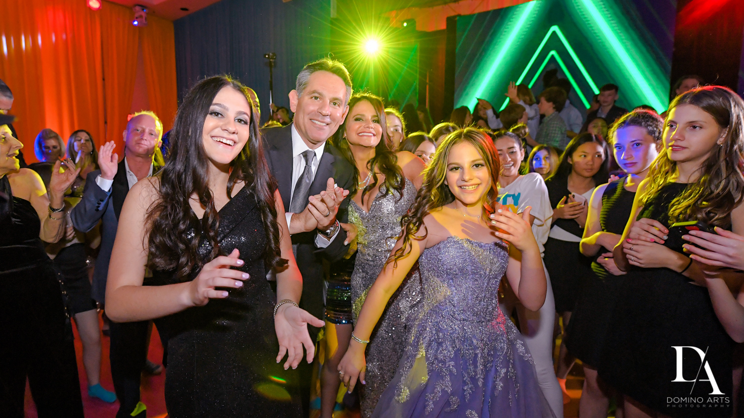 family dancing at Colorful Rainbow BurstBat Mitzvah at Aventura Turnberry Jewish Center by Domino Arts Photography