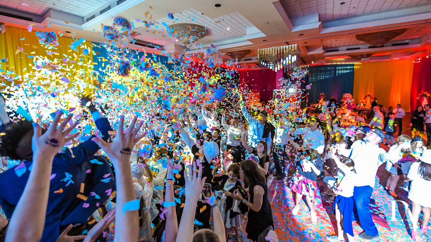 confetti blast at Colorful Rainbow BurstBat Mitzvah at Aventura Turnberry Jewish Center by Domino Arts Photography
