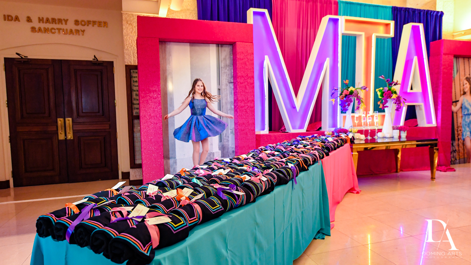 souvenir table at Colorful Rainbow BurstBat Mitzvah at Aventura Turnberry Jewish Center by Domino Arts Photography