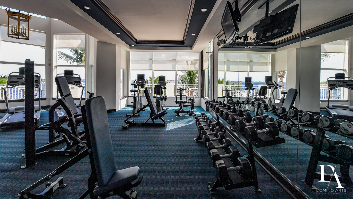 luxury gym at Harborage Yacht Club & Marina by Domino Arts Photography