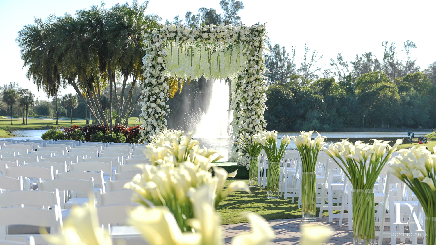best chuppah decor at Sunset Wedding at Boca Rio Golf Club by Domino Arts Photography`