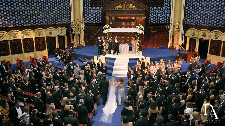 jewish wedding procession at Tropical Luxury Wedding at Temple Emmanu-El in Miami Beach