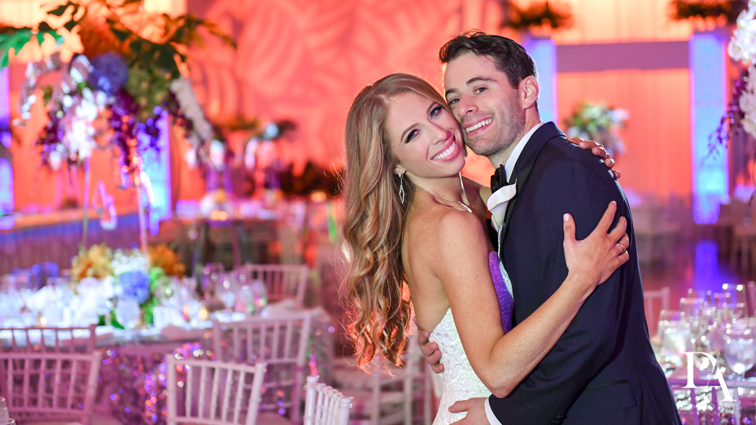 couple with decor at Tropical Luxury Wedding at Temple Emmanu-El in Miami Beach