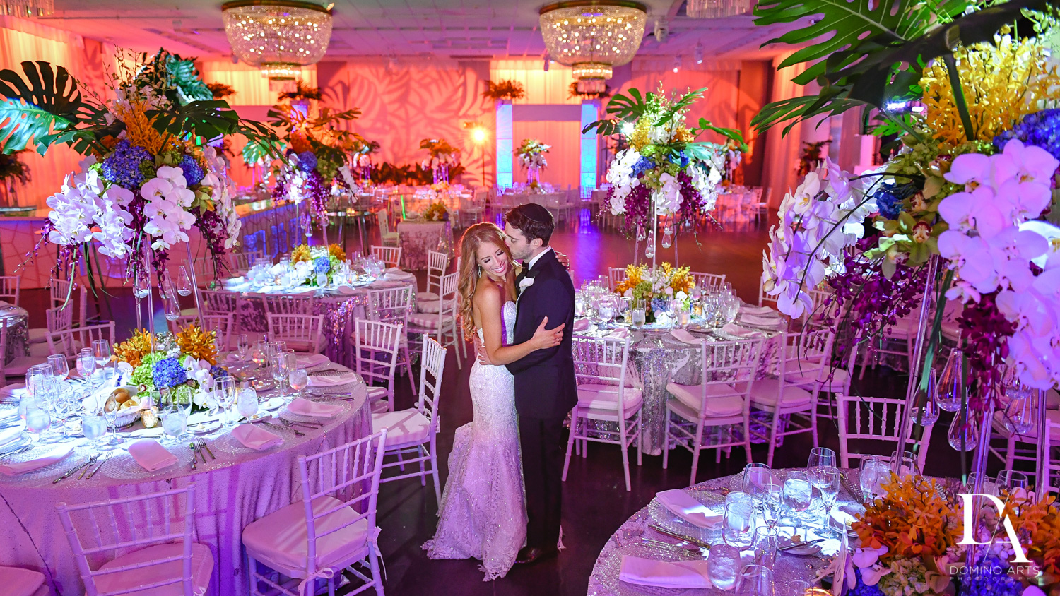 happy couple with room decor at Tropical Luxury Wedding at Temple Emmanu-El in Miami Beach