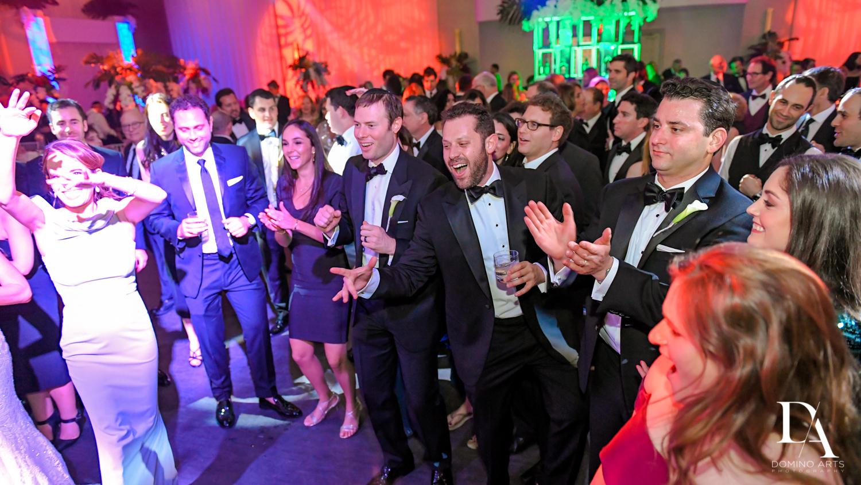 fun dancing at Tropical Luxury Wedding at Temple Emmanu-El in Miami Beach