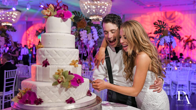cake cutting at Tropical Luxury Wedding at Temple Emmanu-El in Miami Beach
