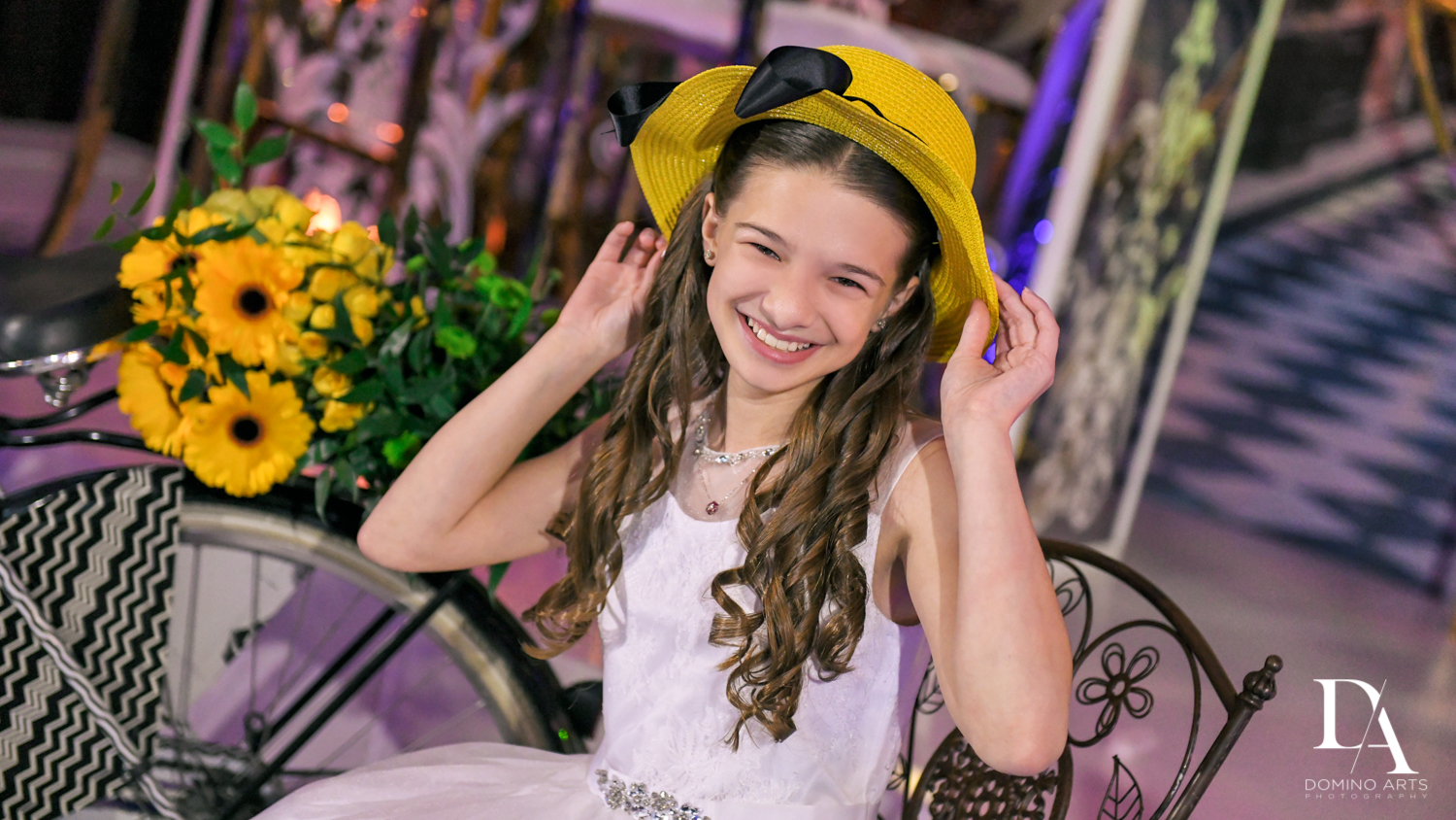 yellow hat prop at Madeline in Paris theme Bat Mitzvah at Boca Raton Resort and Club by Domino Arts Photography