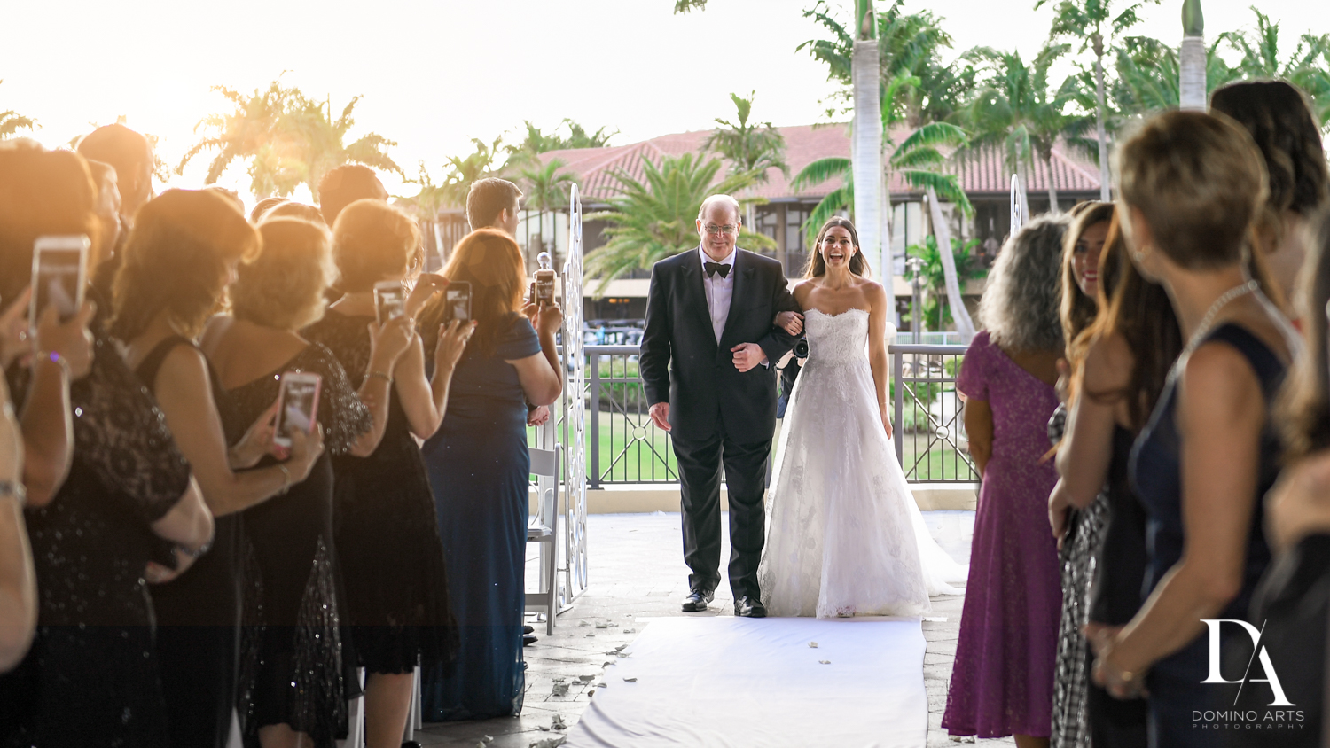 here comes the bride at Stunning Golf Course Wedding at PGA National Palm Beach by Domino Arts Photography
