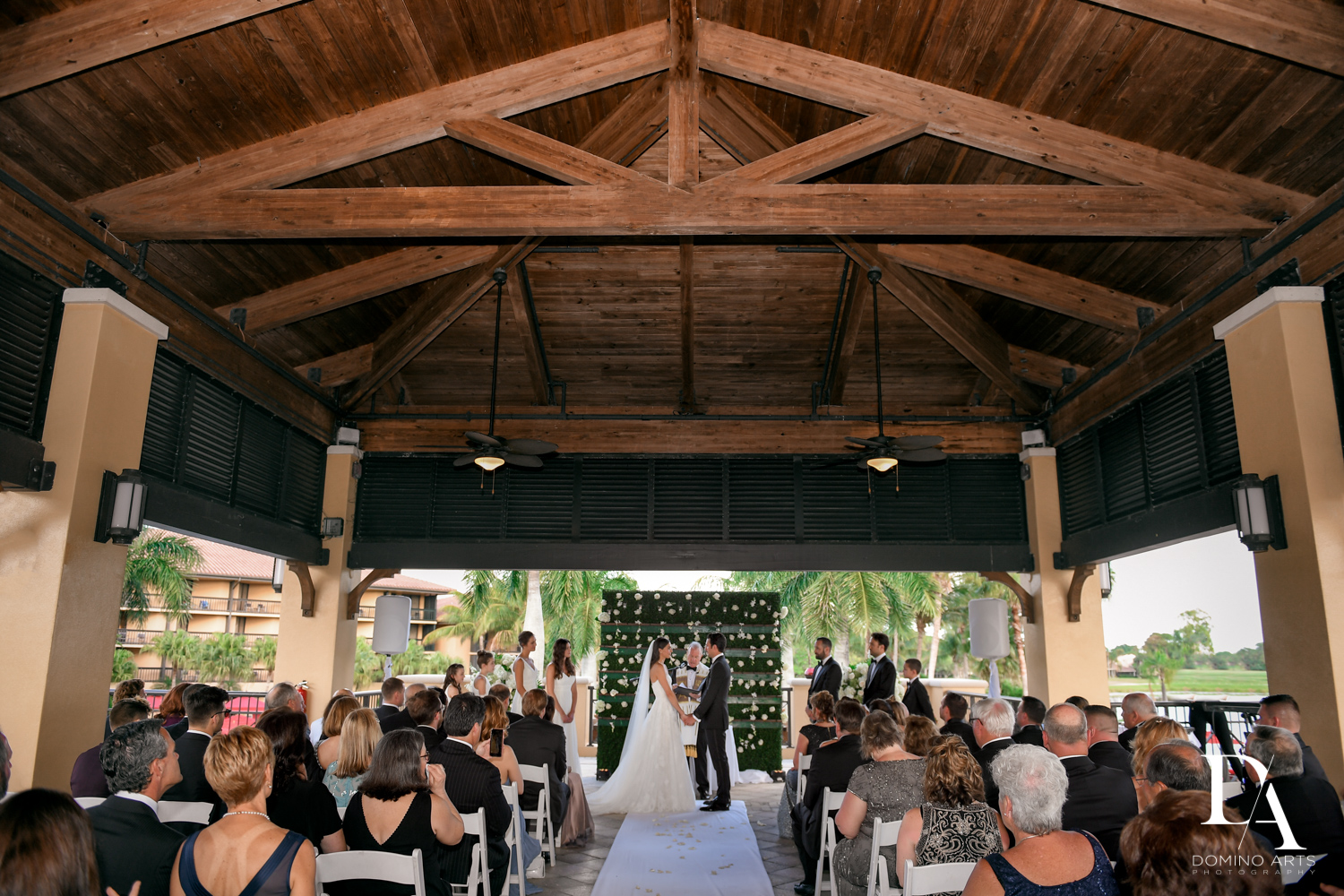 ceremony at Stunning Golf Course Wedding at PGA National Palm Beach by Domino Arts Photography