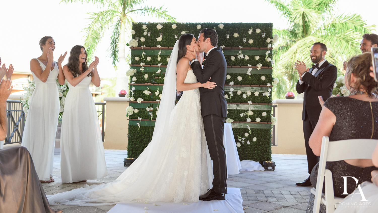 ceremony kiss at Stunning Golf Course Wedding at PGA National Palm Beach by Domino Arts Photography