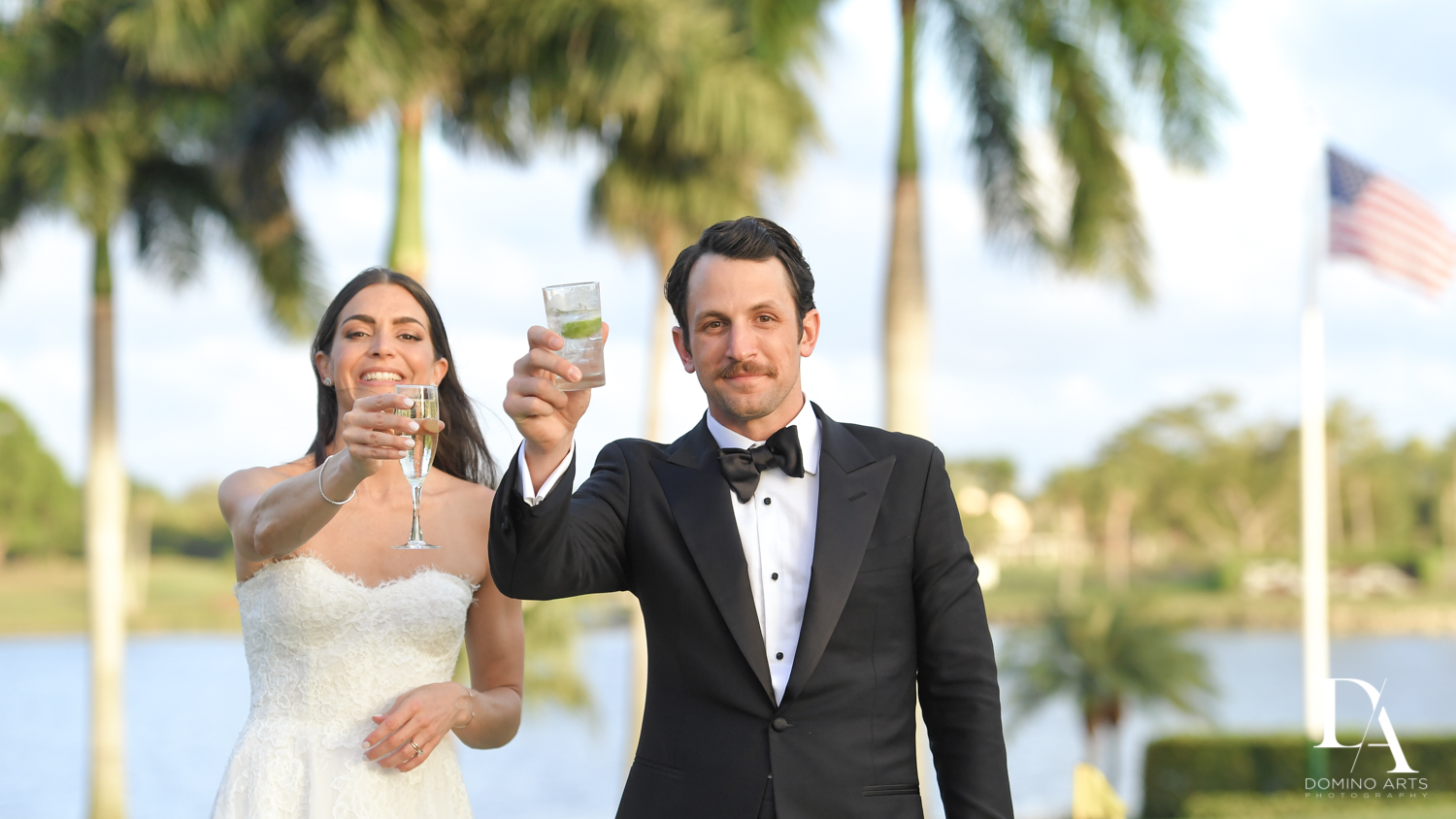 Cheers at Stunning Golf Course Wedding at PGA National Palm Beach by Domino Arts Photography