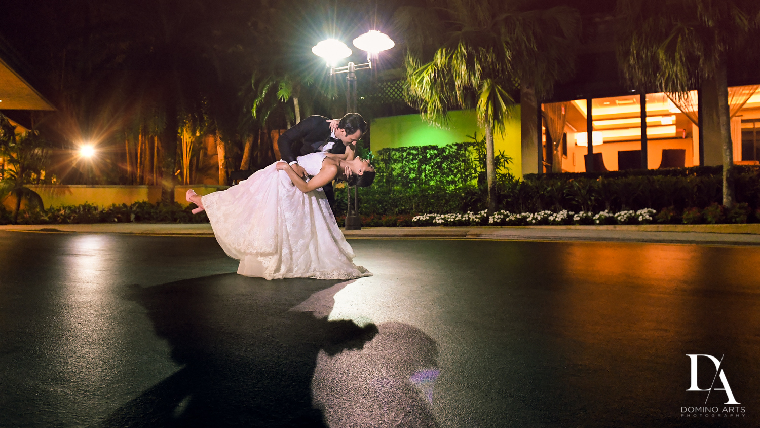 romantic dip at Stunning Golf Course Wedding at PGA National Palm Beach by Domino Arts Photography