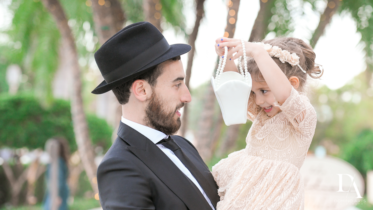 groom with child at Hasidic Jewish Wedding at The Addison in Boca Raton by Domino Arts Photography