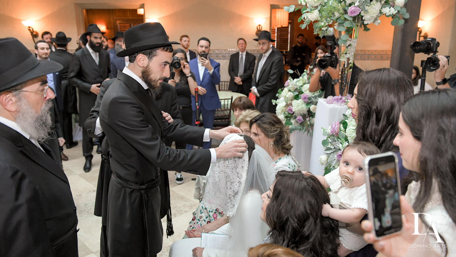 veiling bride at bedeken at Hasidic Jewish Wedding at The Addison in Boca Raton by Domino Arts Photography