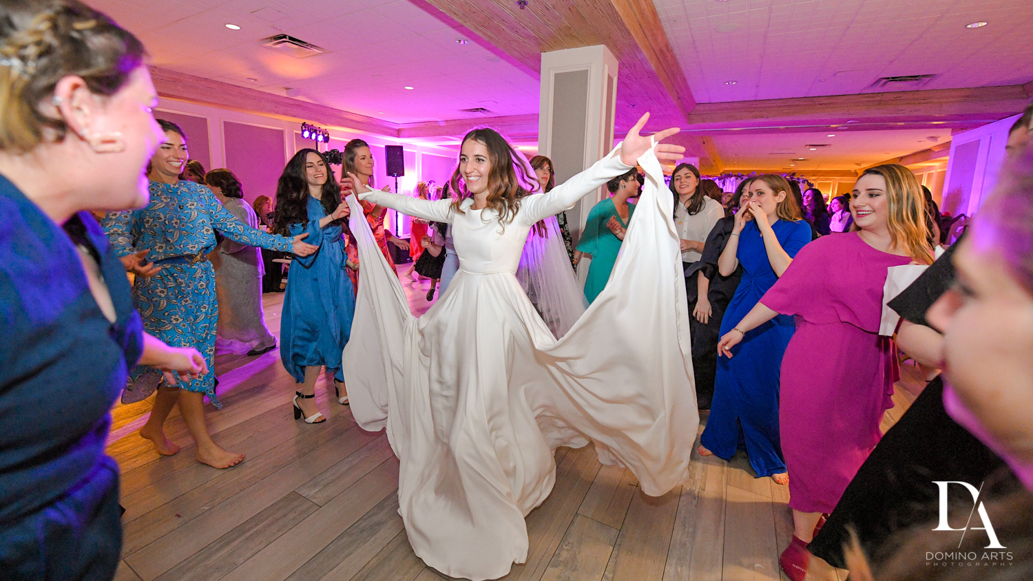women dancing at Hasidic Jewish Wedding at The Addison in Boca Raton by Domino Arts Photography