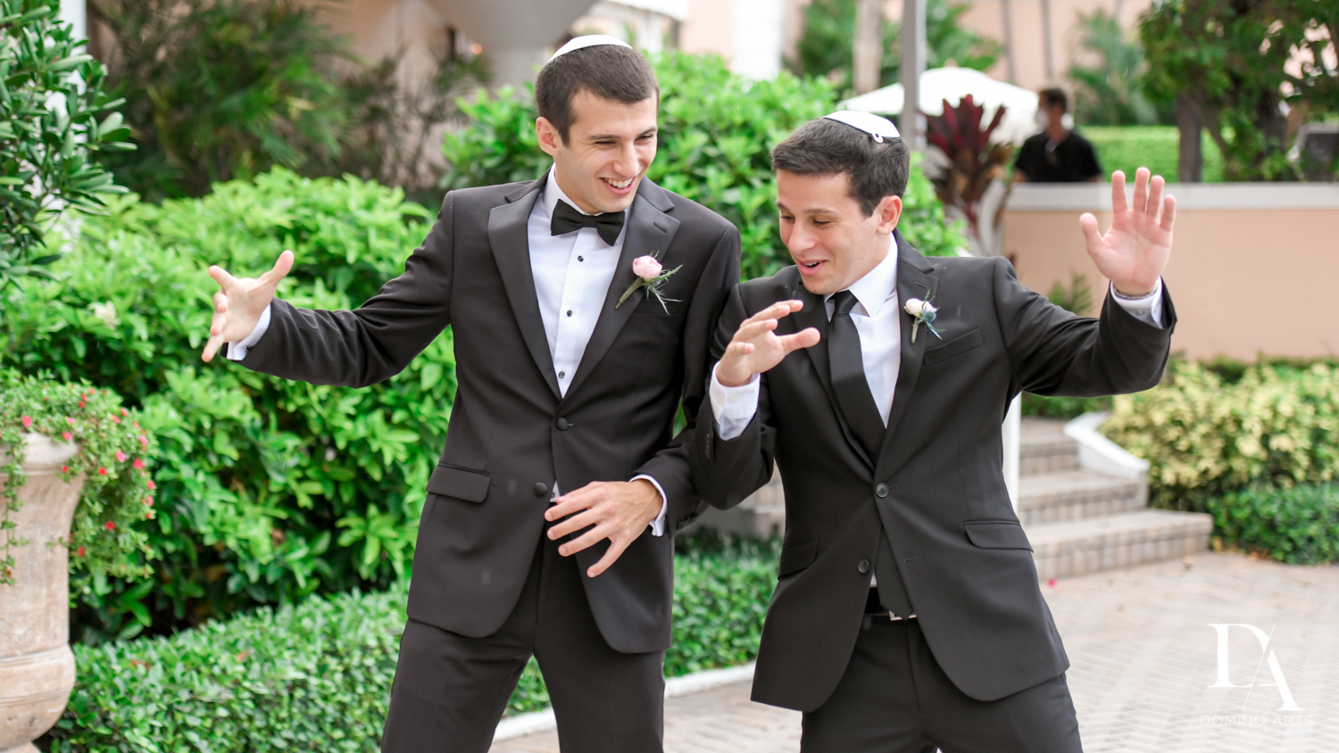 fun groomsmen at Luxury Summer Wedding at The Colony Hotel Palm Beach by Domino Arts Photography