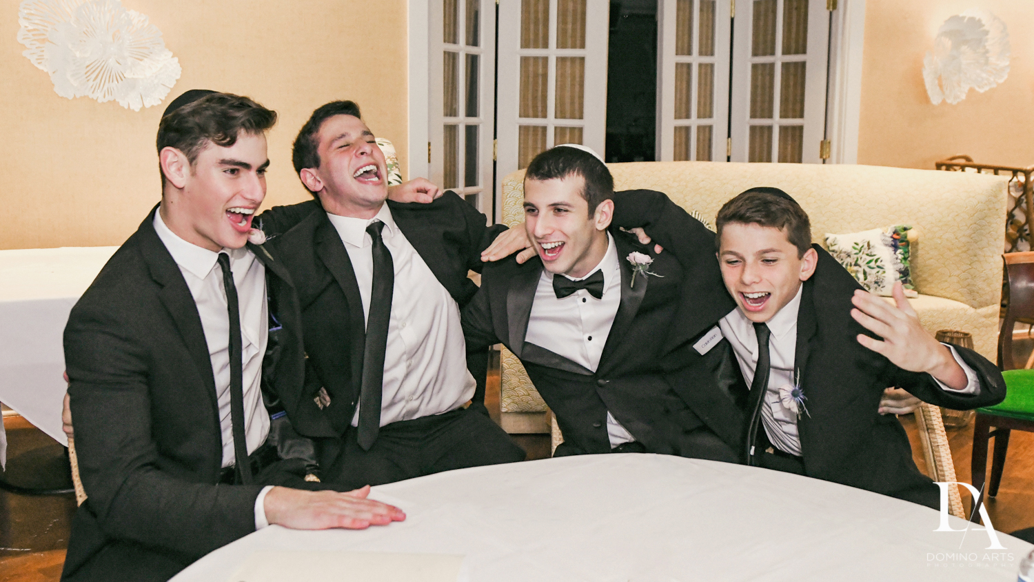 happy groomsmen at Luxury Summer Wedding at The Colony Hotel Palm Beach by Domino Arts Photography