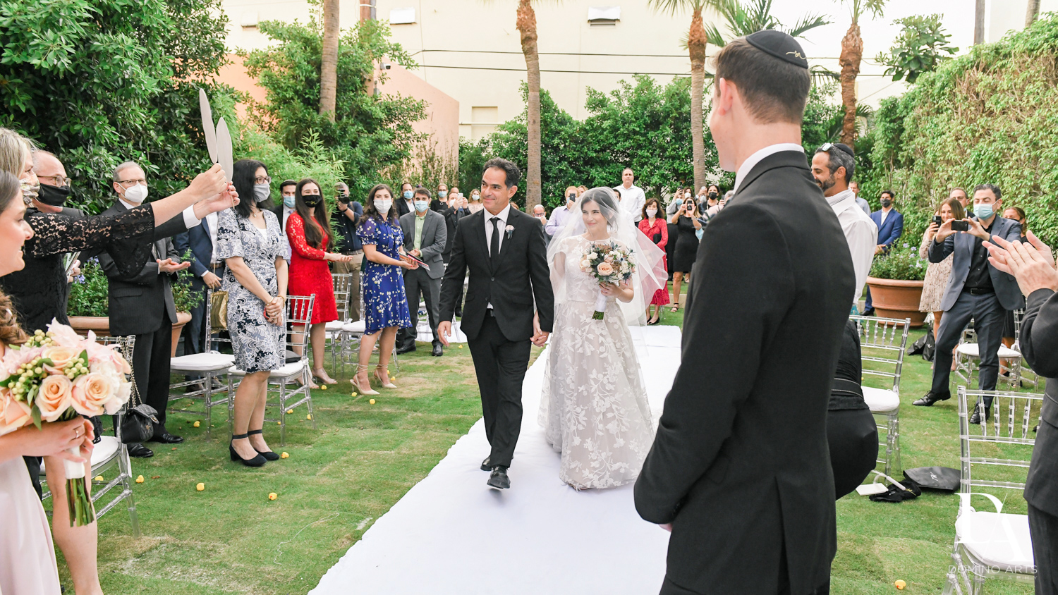 bride walking aisle at Luxury Summer Wedding at The Colony Hotel Palm Beach by Domino Arts Photography
