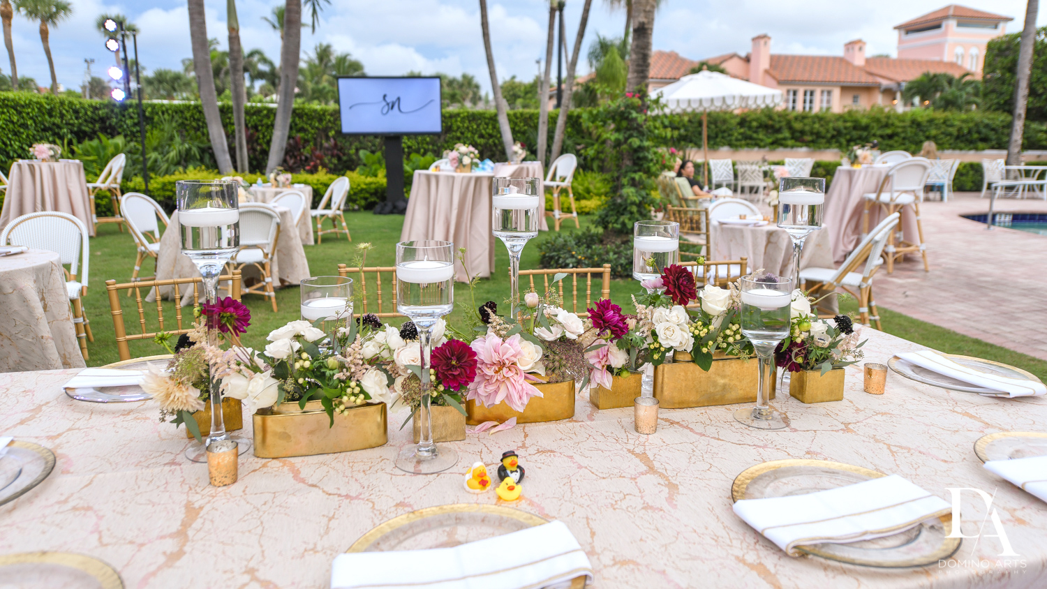 outdoor floral decor at Luxury Summer Wedding at The Colony Hotel Palm Beach by Domino Arts Photography