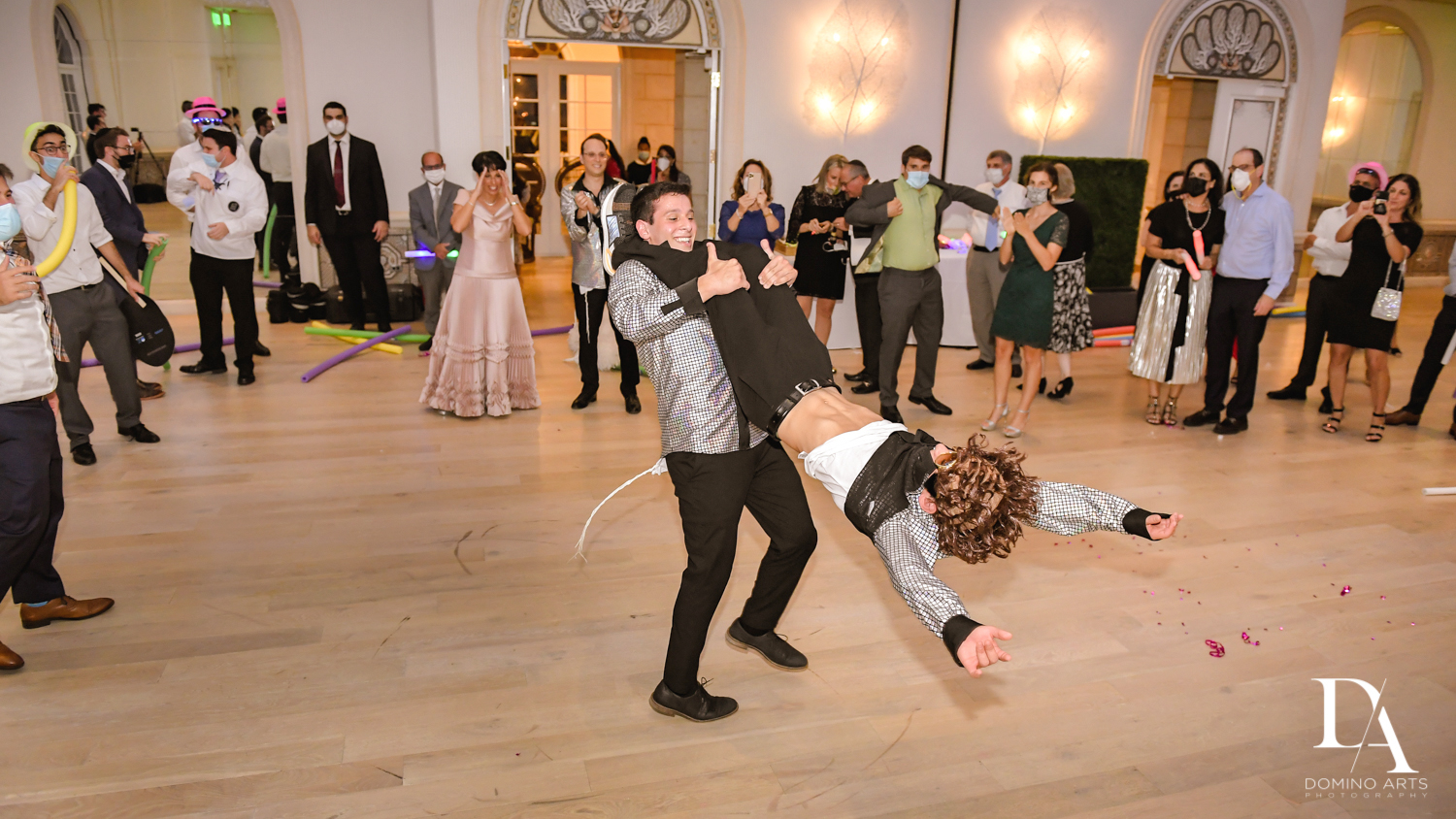 crazy fun party traditions at Luxury Summer Wedding at The Colony Hotel Palm Beach by Domino Arts Photography