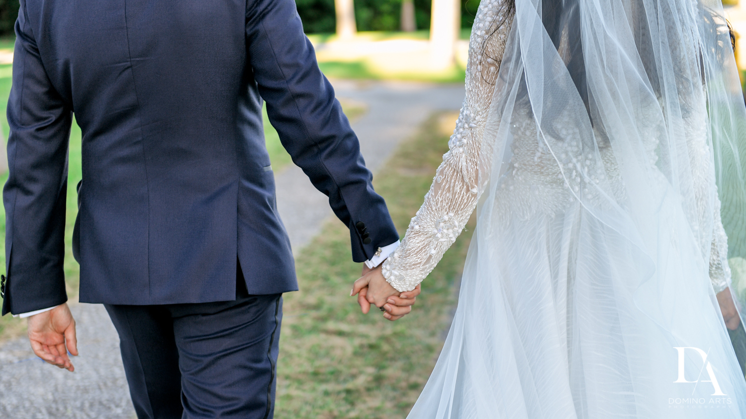 holding hands at Traditional Jewish Wedding at Deering Estate Miami by Domino Arts Photography
