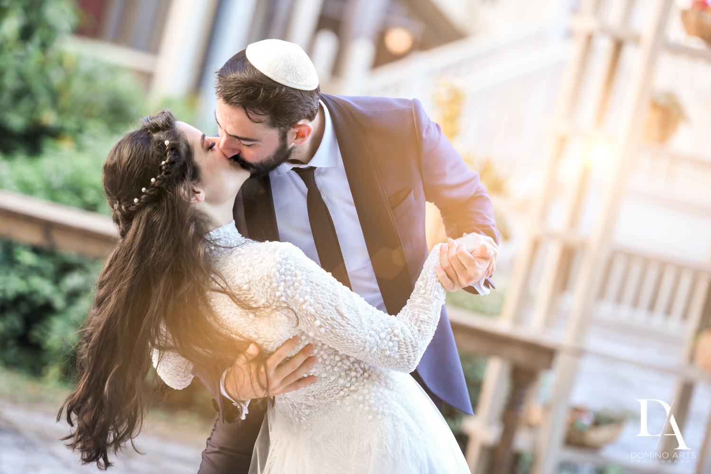 kiss at Traditional Jewish Wedding at Deering Estate Miami by Domino Arts Photography