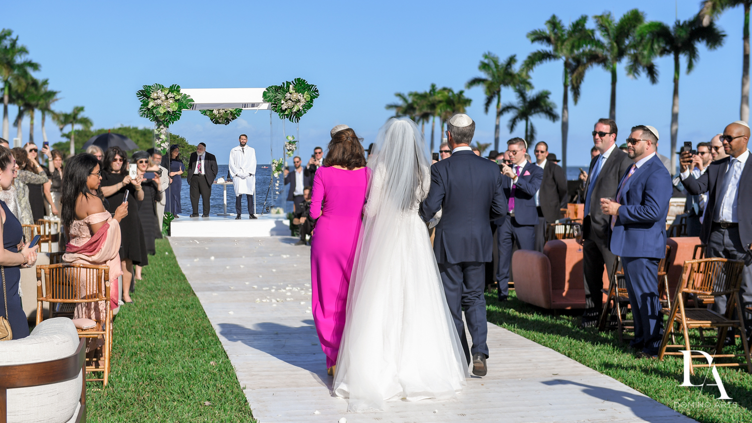 procession at Traditional Jewish Wedding at Deering Estate Miami by Domino Arts Photography