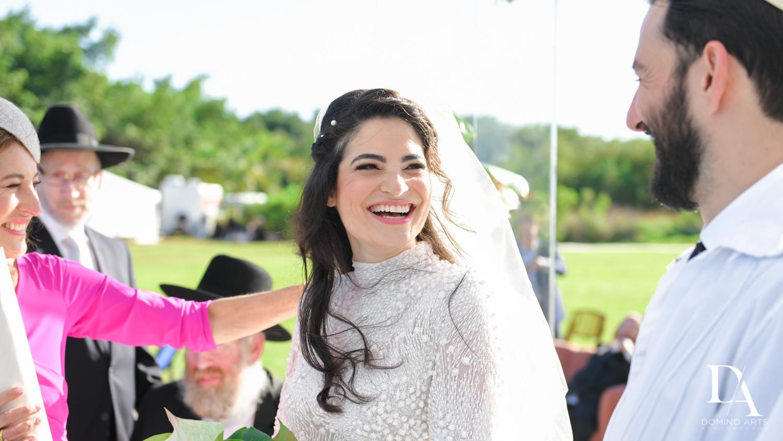 happy bride at Traditional Jewish Wedding at Deering Estate Miami by Domino Arts Photography