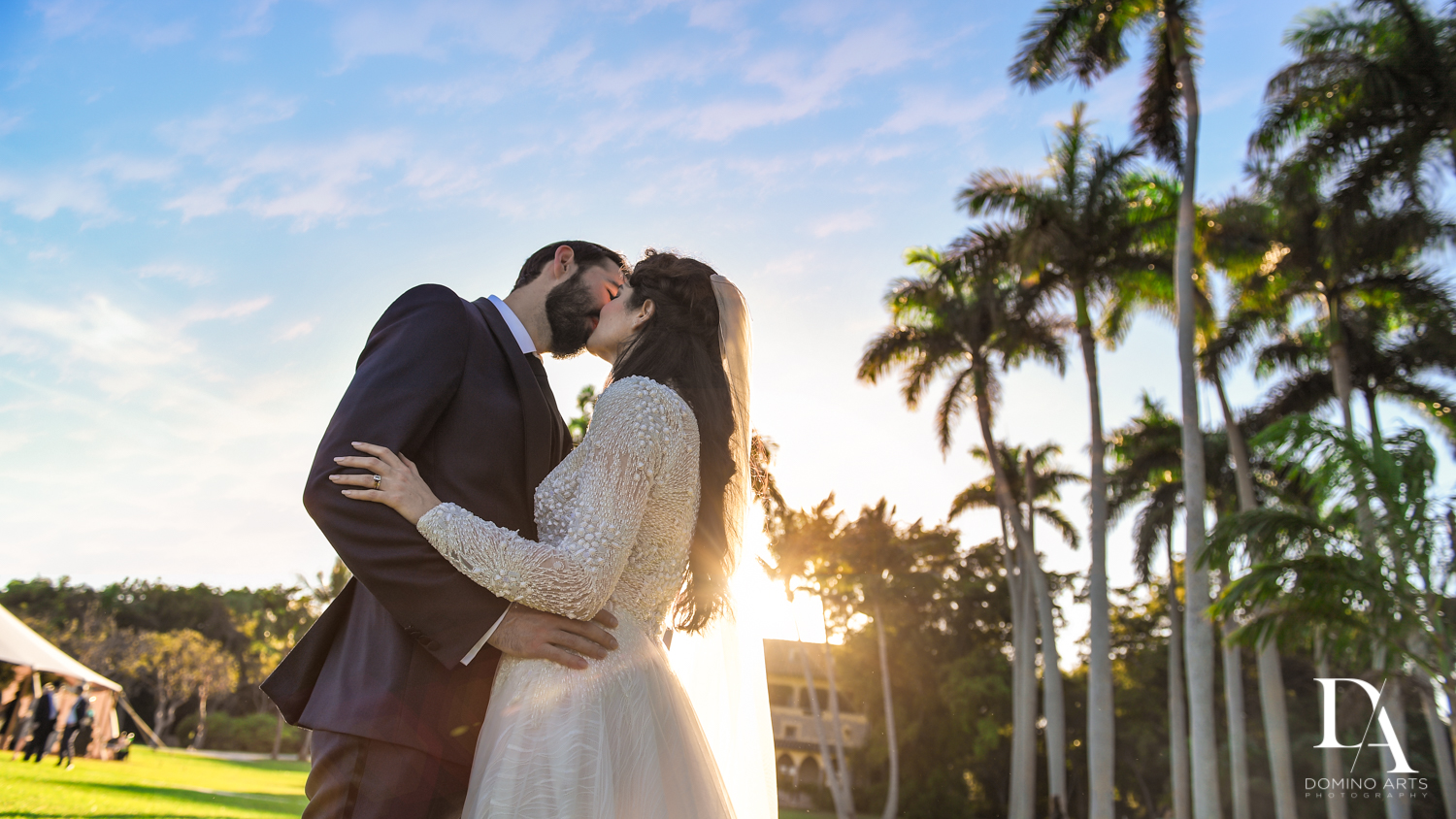 sunset kiss at Traditional Jewish Wedding at Deering Estate Miami by Domino Arts Photography