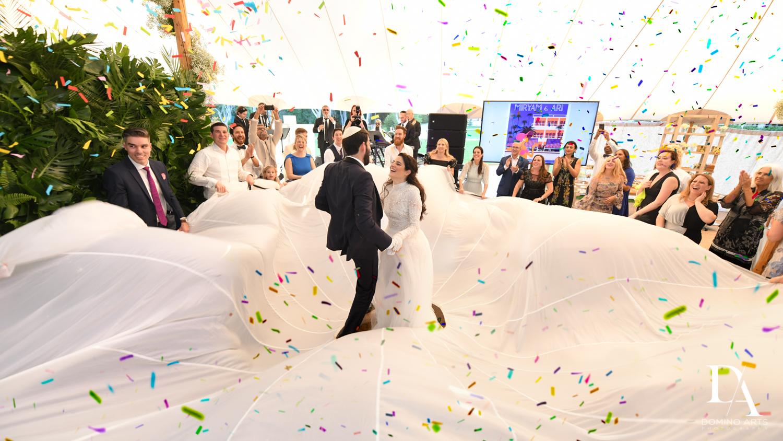 fun customs at Traditional Jewish Wedding at Deering Estate Miami by Domino Arts Photography