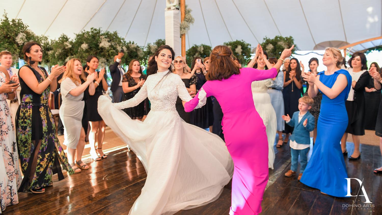 dancing bride at Traditional Jewish Wedding at Deering Estate Miami by Domino Arts Photography