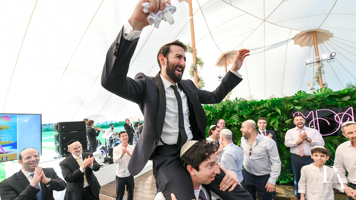 groom hora at Traditional Jewish Wedding at Deering Estate Miami by Domino Arts Photography