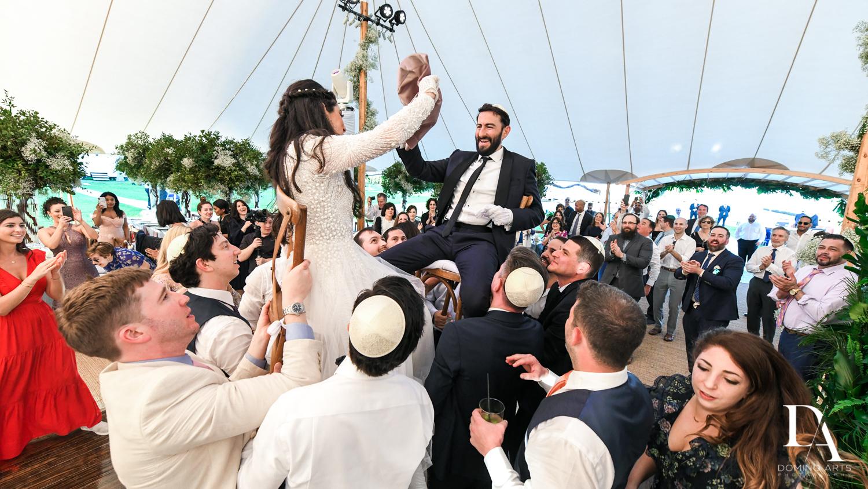 bridal hora at Traditional Jewish Wedding at Deering Estate Miami by Domino Arts Photography