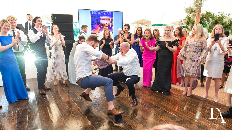 dancing at Traditional Jewish Wedding at Deering Estate Miami by Domino Arts Photography