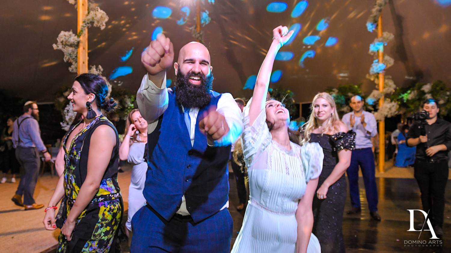 fun crowd at Traditional Jewish Wedding at Deering Estate Miami by Domino Arts Photography
