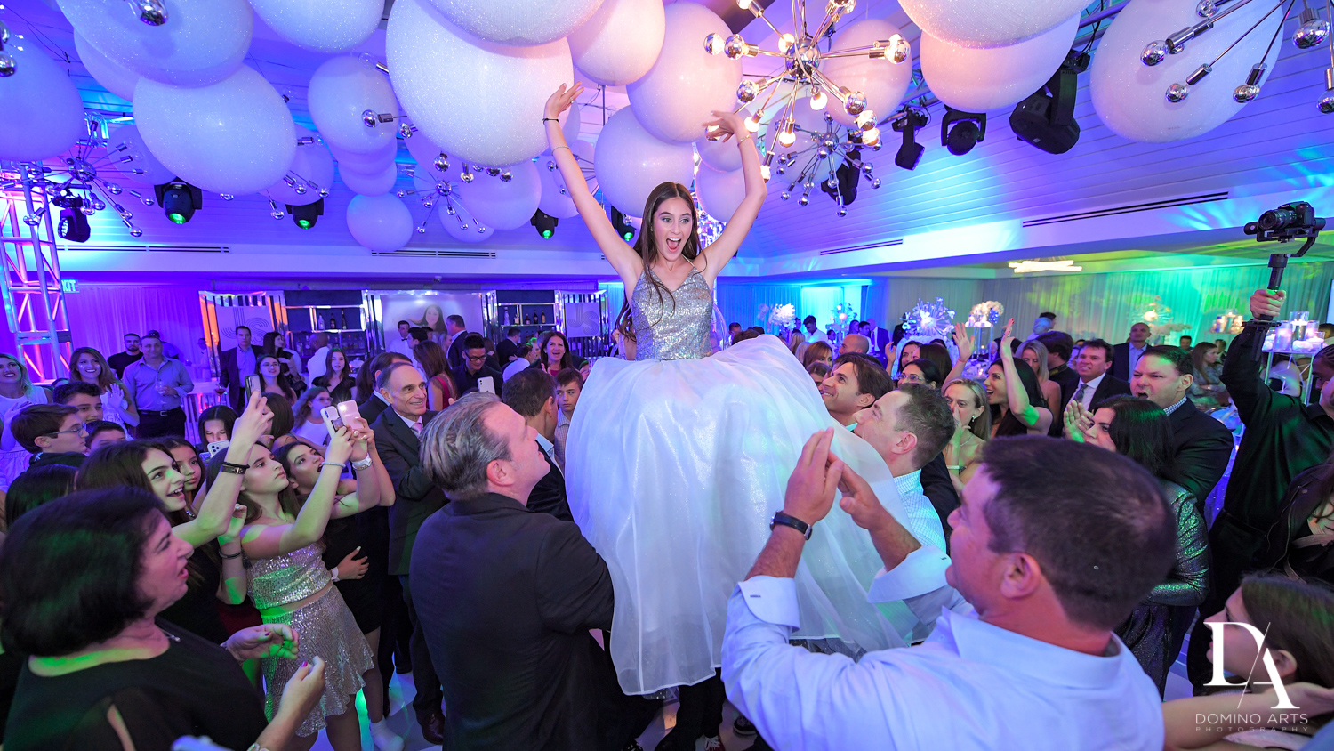 balloon hora at Trendy Decor Bat Mitzvah at St Andrews Country Club by Domino Arts Photography