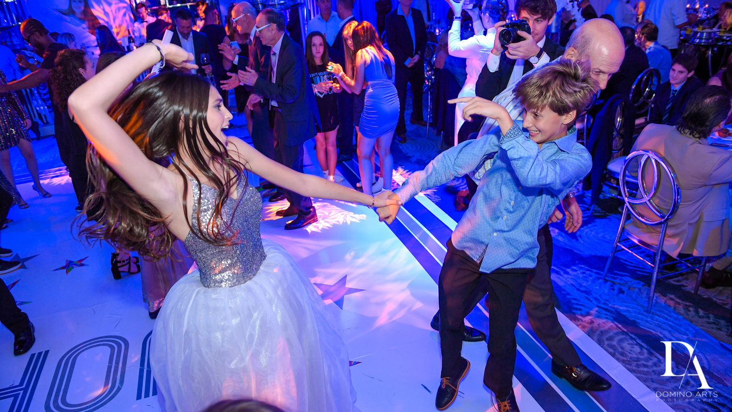 fun dancing at Trendy Decor Bat Mitzvah at St Andrews Country Club by Domino Arts Photography