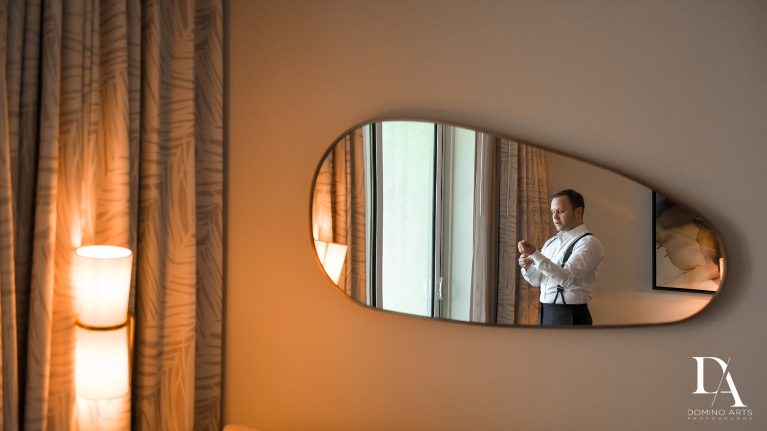 groom getting ready at Lavish Flowers & Crystals Wedding at Aventura Turnberry Jewish Center by Domino Arts Photography