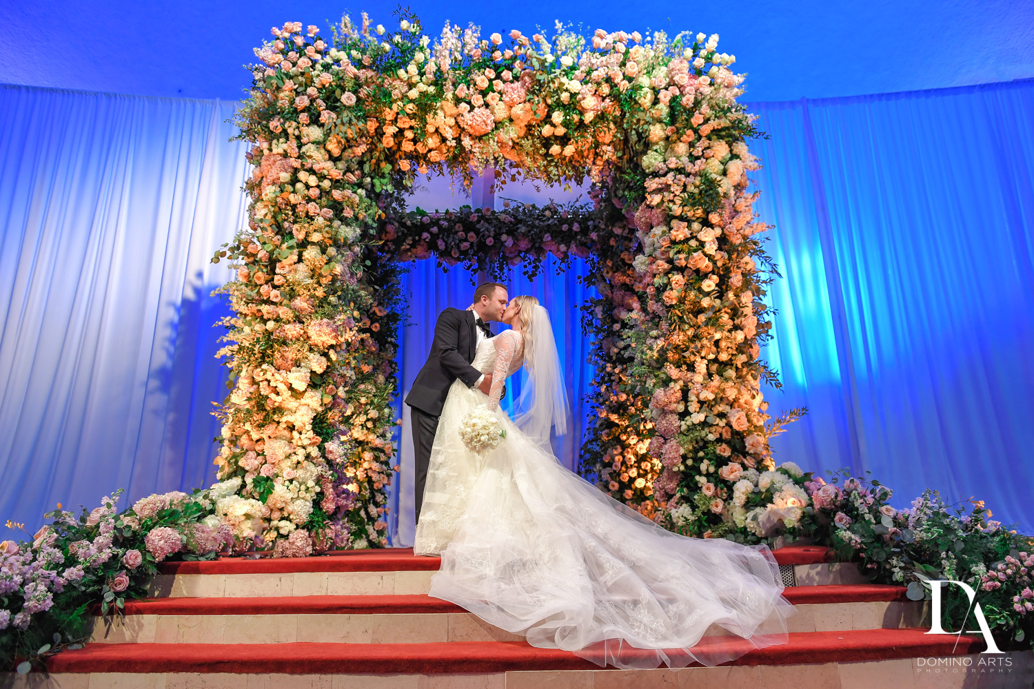 most amazing floral chuppah at Lavish Flowers & Crystals Wedding at Aventura Turnberry Jewish Center by Domino Arts Photography